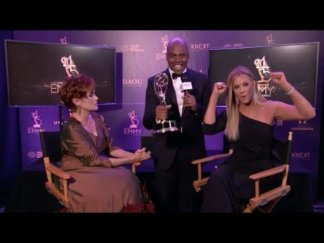 Entertainment Tonight Host Kevin Frazier loves the Carolyn Hennesy Ivey Abitz gown.