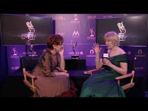 Loretta Swit backstage at the Daytime Emmys interviewed by Carolyn Hennesy. They discuss Jamie Farr, Mister Rogers, MASH, and Ivey Abitz.