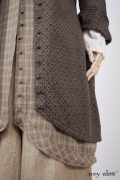 - Truitt Duster Coat in Flaxseed Embroidered Eyelet - Truitt Shirt in Dove Striped Voile  - Holkham Hall Necktie in Flaxseed Leafy Silk Linen  - Truitt Frock in Flaxseed Plaid Weave  - Montague Trousers in Sandy Pinstriped Linen, High Water Length