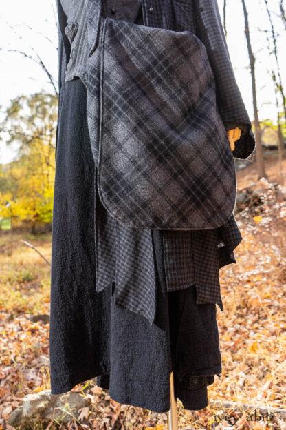Vanetten Duster Coat in Midnight Train Checked Wool; Vanetten Frock in Midnight Train Pebbled Cotton Linen; Canterbury Cardigan in Rail Melange Knit; Vanetten Sash in Midnight Train Checked Wool; Solomon Bag in Rail Plaid Wool.