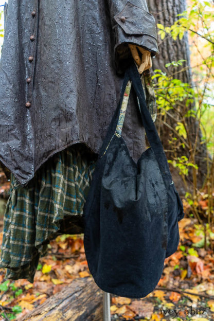 Camilla Raincoat in Saddle Waxed Cotton Lined in Horse Ride in the Hamlet; Limited Edition Gilbert Cardigan in Woodland Trail Softest Stripe Knit; Fitz Frock in Woodland Trail Soft Plaid Wool; Cilla Slip Frock in Woodland Trail Melange Knit; Solomon Bag in Midnight Train Fine Cotton Cord.