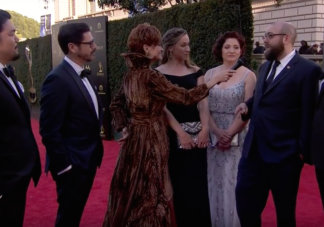 Carolyn Hennesy wears Ivey Abitz on the Emmys red carpet whilst interviewing directors and editors of Disney's Ducktales