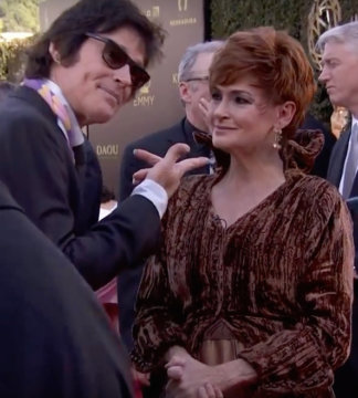 Carolyn Hennesy wears Ivey Abitz on the Emmys red carpet whilst interviewing actor Ron Moss