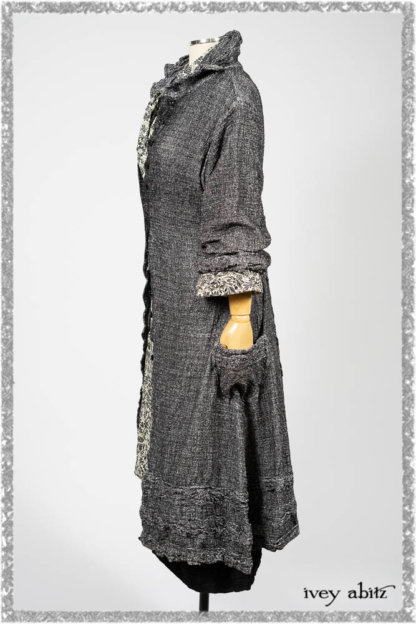 Bartholomew Duster Coat in Black White Painted Puckery Weave; Clotaire Sash in Ethereal Cream and Black Fleur Stretch Cotton; Tollie Dress in Ethereal Cream and Black Fleur Stretch Cotton; Mewland Skirt in Black Washed Crinkled Linen. Ivey Abitz bespoke clothing.