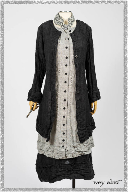 Mewland Jacket in Black Washed Crinkled Linen; Clotaire Sash in Ethereal Cream and Black Fleur Stretch Cotton; Mewland Vest in Beacon Black Embroidered Plaid on Petite Stripe; Mewland Skirt in Black Washed Crinkled Linen. Ivey Abitz bespoke clothing.