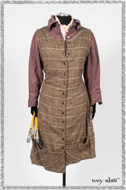 Porte Cochere Frock in Earthen and Plum Stretch Plaid; Fairholme Shirt in Plum Tree Washed Linen; Blanchefleur Sash in Ethereal Floral Cotton Voile. Ivey Abitz bespoke clothing.
