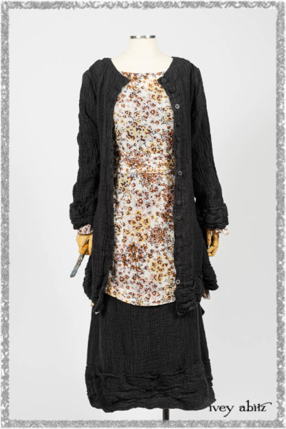 Mewland Jacket in Black Washed Crinkled Linen; Bramley Dress in Plum Tree Watercolour Floral Voile; Mewland Skirt in Black Washed Crinkled Linen; Cilla Slip Frock in Beacon Black Washed Ribbed Knit. Ivey Abitz bespoke clothing.
