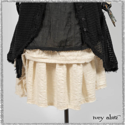 Ardsley Duster Coat in Beacon Black Lace Netted Knit; Clotaire Sash in Ethereal Cream and Black Fleur Stretch Cotton; Ardsley Frock in Beacon Black Hemstitch Stripe Gauze; Ardsleydale Frock in Ethereal Cream Embroidered Crushed Plaid. Ivey Abitz bespoke clothing.