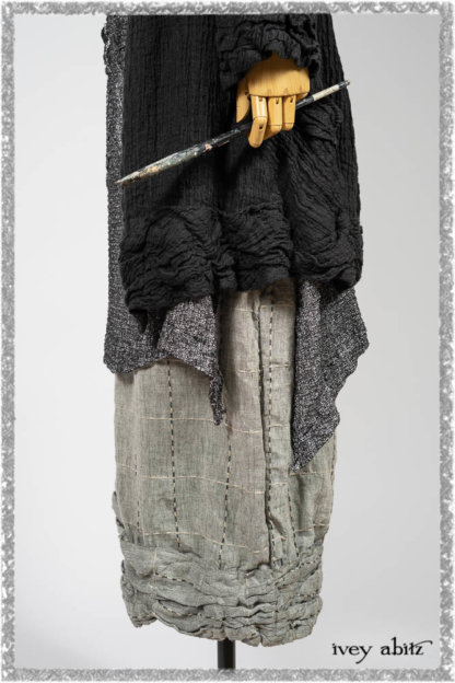 Mewland Jacket in Black Washed Crinkled Linen; Clotaire Sash in Ethereal Cream and Black Fleur Stretch Cotton; Bramley Overlay in Black White Painted Puckery Weave; Mewland Trousers in Beacon Blcak Embroidered Plaid on Petite Stripe. Ivey Abitz bespoke clothing.