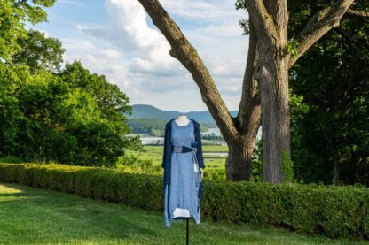 Chittister Shirt Jacket in Hudson Blue Washed Crinkled Linen; Fairholme Sash in Hudson Blue Plaid Crinkled Linen; Chittister Frock in Buoy Blue Washed Crinkled Linen; Limited Edition Cilla Slip Frock in Shipsail Embroidered Voile. Ivey Abitz at Boscobel House and Gardens