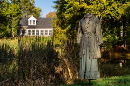 Gabled Duster Coat in Peace and Civility Stripe Linen; Gabled Shirt Jacket in Civility Washed Linen; Gabled Trousers in Civility Washed Stretch Weave; Clotaire Sash in Civility Garden Row Silk Chiffon. Location: Near the bridge and entrance to Stone Cottage and Val-Kill Cottage, the home of Eleanor Roosevelt. Eleanor Roosevelt National Historic Site, Hyde Park, New York.