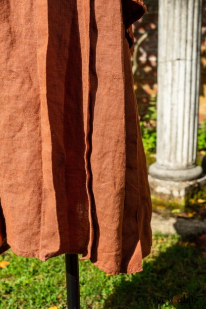 Truitt Shirt Jacket in Independence Embroidered Washed Silk; Eleanora Frock in Independence Washed Linen. Location: Inside the walled garden at the Eleanor Roosevelt National Historic Site. Val-Kill Cottage, Hyde Park, New York.
