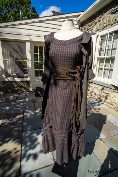 Hudson Duster Coat in Peace Soft Pinstripe Cotton; Hudson Frock in Civility Soft Check Twill; Porte Cochere Sash in Civility Floral Stretch Weave; Cilla Slip Frock in Unity Soft Ribbed Knit. Location: Entrance to Stone Cottage. Hyde Park, New York.