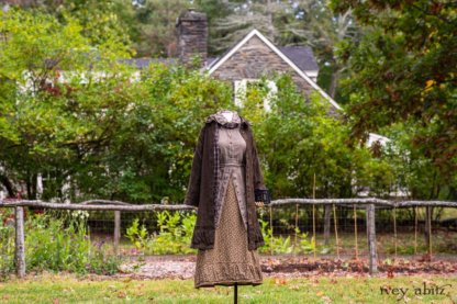 Gabled Duster Coat in Civility Floral Stretch Weave; Gabled Shirt Jacket in Civility Washed Linen; Baedeker Scarf in Dignity Soft Plaid Flannel; Gabled Skirt in Dignity Floral Cotton Twill. Location: Eleanor's garden and west profile of Stone Cottage. Eleanor Roosevelt National Historic Site. Val-Kill, Hyde Park, New York.