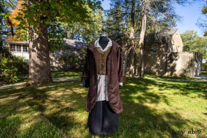 Eleanora Duster Coat in Dignity Soft Wale Cord; Highlands Vest in Dignity Cotton Plaid Velvet; Pierrepont Shirt in Dignity Washed Vine Silk; Vanetten Trousers in Unity Washed Cord. Location: Center of grounds between main house (that was a former furniture factory) and Stone Cottage. Hyde Park, New York.Val-Kill,