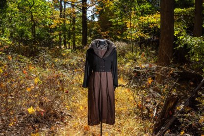 """Limited Edition Eleanora Jacket in Unity Soft Ribbed Knit with Looped Mohair Collar; Fairholme Sash in Civility Garden Row Silk Chiffon; Eleanora Frock in Dignity Washed Linen. Location: """"Eleanor's Walk,"""" trails at the Eleanor Roosevelt National Historic Site. Val-Kill, Hyde Park, New York."""