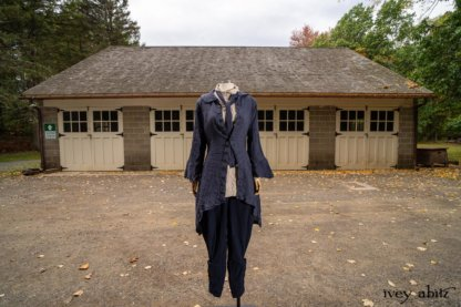 Heraldry Duster Coat in Washed Crinkled Weave; Crest Shirt in Respect Raised Pinstripe Weave; Fairholme Necktie Liberty Washed Crinkled Weave; Chevallier Trousers in Liberty and Unity Pinstripe Weave. Location: Stable at Val-Kill, Eleanor Roosevelt National Historic Site.