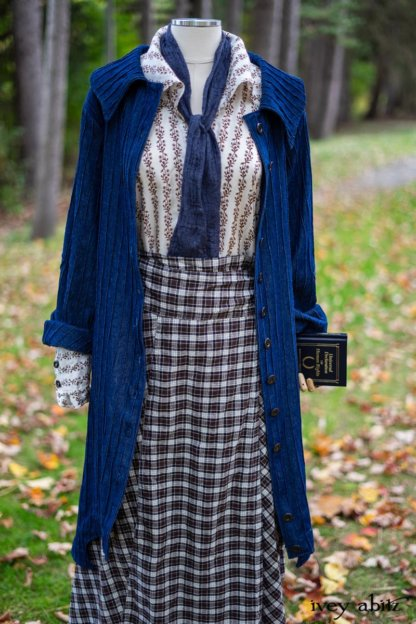 Chittister Duster Coat in Liberty Pin Tuck Twill; Pierrepont Shirt in Dignity Washed Vine Silk; Fairholme Necktie in Liberty Washed Crinkled Weave; Fairholme Skirt in Dignity Plaid Cotton. Location: Path behind house and next to pond at the Eleanor Roosevelt National Historic Site. Val-Kill, Hyde Park, New York.