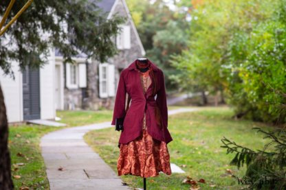 Montague Jacket in Independence Washed Cord; Blanchefleur Sash in Independence Washed Silk Chiffon; Inglenook Frock in Independence Floral Linen. Location: Path leading to loggia and Stone Cottage. Eleanor Roosevelt National Historic Site. Val-Kill, Hyde Park, New York.
