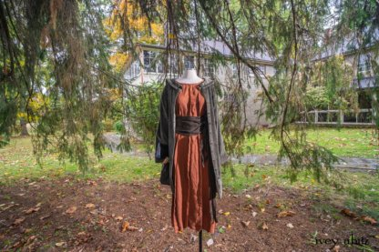Hudson Duster Coat in Peace Variegated Cotton Corduroy; Porte Cochere Sash in Dignity Floral Stretch Weave; Eleanora Frock in Independence Washed Linen. Location: Under the mighty cedar tree beside Val-Kill Cottage that Eleanor looked out at every morning and night from her bedroom. Eleanor Roosevelt National Historic Site. Hyde Park, New York.