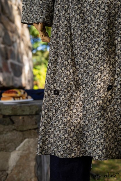 Baedeker Dress in Dignity Cottage Weave; Pierrepont Breeches-Leggings in Liberty Washed Stretch Twill; Chittister Duster Coat in Liberty Pin Tuck Twill (draped on stone fireplace). Location: Stone grill where Eleanor would serve hotdogs to dignitaries (she served hotdogs to King George of England up the hill from this location), family, and friends. Eleanor Roosevelt National Historic Site. Val-Kill, Hyde Park, New York.