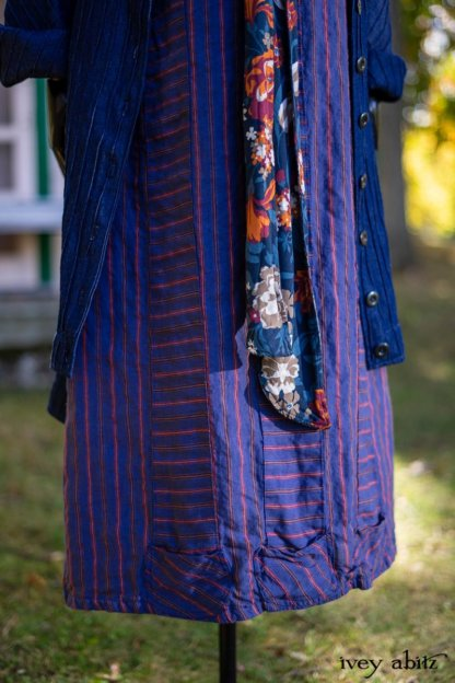 """Chittister Duster Coat in Liberty Pin Tuck Twill; Blanchefleur Sash in Independence Cottage Garden Weave; Campanella Frock in Honour Washed Stripe Linen. Location: In front of the """"doll house"""" next to pond for Eleanor's grandchildren. Eleanor Roosevelt National Historic Site. Val-Kill, Hyde Park, New York."""