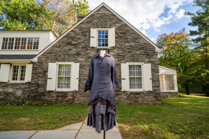 Heraldry Duster Coat in Liberty Crinkled Washed Weave; Heraldry Vest in Dignity Soft Check Twill; Heraldry Frock in Liberty Plaid Linen; Fairholme Necktie in Liberty Washed Crinkled Weave. Location: West profile of Stone Cottage at the Eleanor Roosevelt National Historic Site.