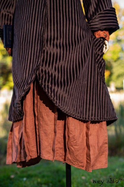 Eleanora Duster Coat in Dignity Soft Wale Corduroy; Truitt Shirt Jacket in Independence Embroidered Washed Silk; Baedeker Scarf in Unity Floral Silk Velvet; Eleanora Frock in Independence Washed Linen. Location: In front of creek and Stone Cottage at the Eleanor Roosevelt National Historic Site. Val-Kill, Hyde Park, New York.