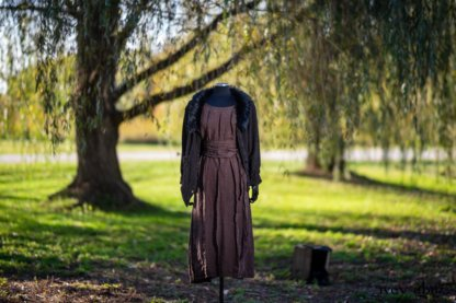 Limited Edition Coulson Cardigan in Dignity Soutache Knit; Eleanora Frock in Dignity Washed Linen; Eleanora Sash in Dignity Washed Linen; Cilla Slip Frock in Unity Soft Ribbed Knit. Location: Under willow tree and next to path connecting Eleanor's idyll to the world. Eleanor Roosevelt National Historic Site. Hyde Park, New York.