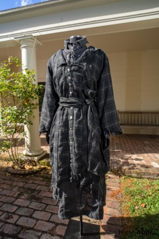 Vanetten Duster Coat in Unity Plaid Linen; Vanetten Shirt in Unity Embroidered Stitch Silk; Clotaire Sash in Unity Floral Silk Chiffon; Vanetten Frock in Unity Embroidered Loop Stripe Challis; Cilla Slip Frock in Unity Soft Ribbed Knit. Location: Loggia behind Stone Cottage at Eleanor Roosevelt National Historic Site.
