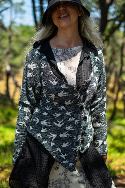 Elliot Jacket in Beacon Black Flora and Fauna Knit; Inglenook Shirt Jacket in Beacon Black Stripe Twill Silk; Fairholme Dress in Ethereal Cream and Black Floral Voile; Cilla Slip Frock in Sailcloth Soft Ribbed Knit. Ivey Abitz Bespoke Clothing.