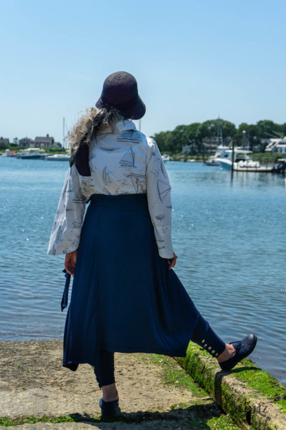 Highlands Shirt in National Seashore Sail Cotton; Clotaire Sash in National Seashore Floral Silk Chiffon; Cilla Camisole in Sailcloth Soft Ribbed Knit; Highlands Skirt in National Seashore Washed Ribbed Knit; Pierrepont Breeches-Leggings in National Seashore Washed Ribbed Knit. Ivey Abitz Bespoke Clothing.