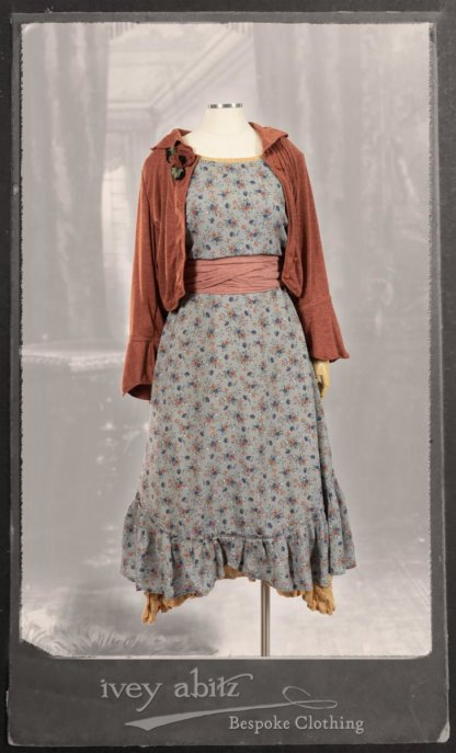 Bertie Jacket in New Sun Softest Knit; Floravinea Brooch in Rosy Washed Crinkled Linen; Tilbrook Frock in Fresh Water Floral Weave; Edenshire Frock in New Sun Washed Linen in High Water Length; Porte Cochere Sash in Rosy Washed Cotton. By Ivey Abitz.