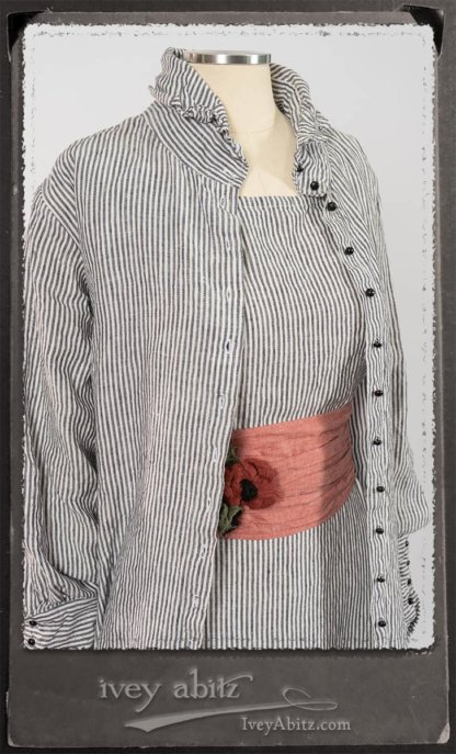 Scattergood Shirt Jacket in Black and White Petite Stripe Linen; Scattergood Frock in Black and White Petite Stripe Linen; Porte Cochere Sash in Rosy Washed Cotton; Floravinea Brooch in Rosy Washed Crinkled Linen. By Ivey Abitz.