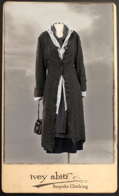 Highlands Duster Coat in Tintype Puckered Stripe Weave; Highlands Shirt in Fresh Water Puckered Stripe Cotton; Clotaire Sash in Fresh Water Argyle Netting; Highlands Skirt in Fresh Water Argyle Netting; Elliot Dress in Fresh Water Melange Knit. By Ivey Abitz.