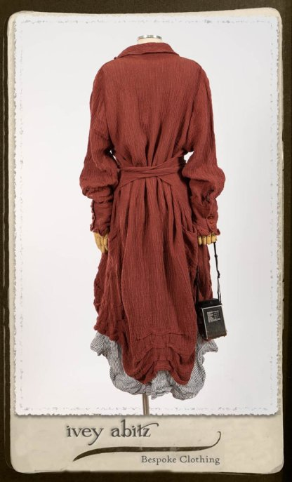 Scattergood Duster Coat in Rosy Washed Crinkled Linen; Scattergood Frock in Black and White Petite Stripe Linen; Floravinea Brooch in Rosy Washed Crinkled Linen. By Ivey Abitz.