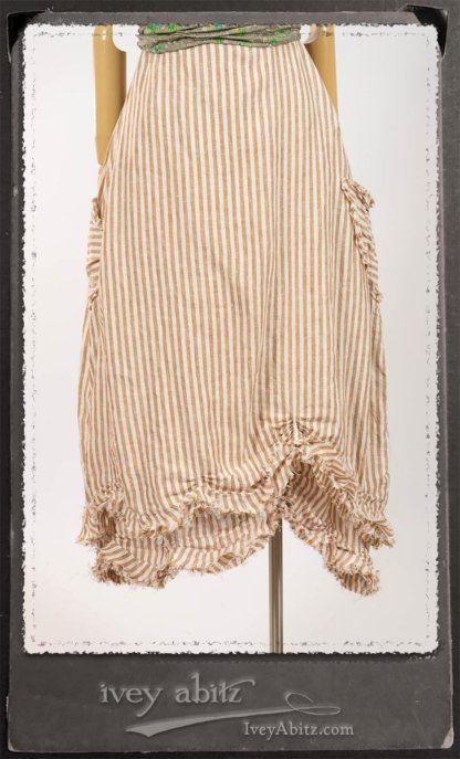 Au Sable Frock in Camera Case Washed Stripe Linen in High Water Length; Au Sable Skirt in Camera Case Washed Stripe Linen; Blanchefleur Sash in New Day Floral Cotton Voile. By Ivey Abitz.