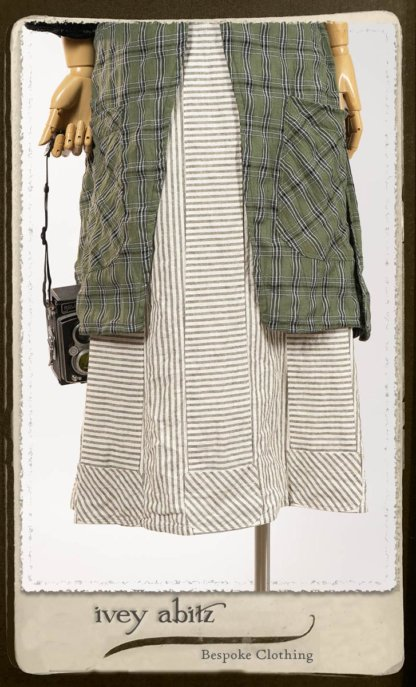 Campanella Overlay in New Day Washed Plaid Gauze; Addy Jacket in Signature Black Lightweight Linen Knit; Campanella Frock in New Day Washed Stripe Linen. By Ivey Abitz.