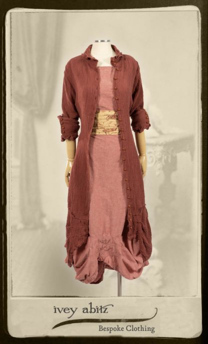 Scattergood Duster Coat in Rosy Washed Crinkled Linen; Porte Cochere Sash in Rosy Washed Floral Linen; Scattergood Frock in Rosy Washed Cotton. By Ivey Abitz.
