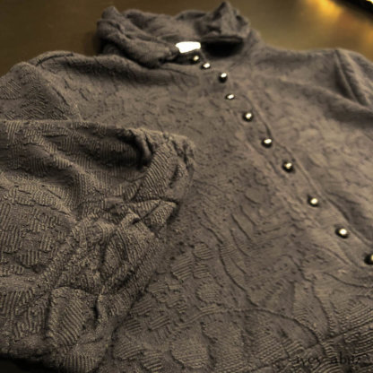 Bertie Jacket in Black Floral Raised Knit. Adorned with antique buttons, circa early 1900's.