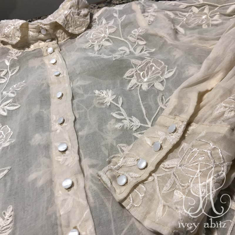 Truitt Shirt in Gardenia Crewel Work on Organdy, adorned with antique glass buttons, circa early 1900's.