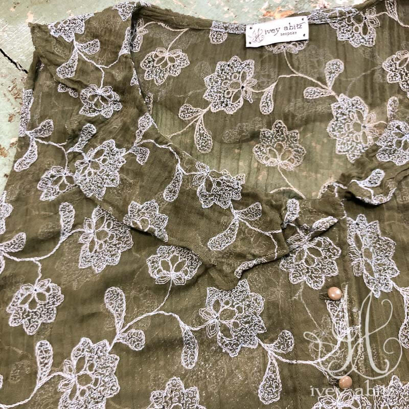 Chevallier Vest in Flora Embroidered Gauze, adorned with antique buttons, circa early 1900's.