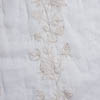 Purpose: Woven for our shirt designs. Description: Centuries old crewel work detail is woven onto an ethereal cotton organdy base. We put it through our special antique washing to soften it and bring out its texture. The result is some of the most glorious crewel work we have ever seen in a modern day fabric. Content: 100 percent cotton. Care: Simply hand wash or put through machine delicate cycle in cold water with a plant based detergent. We suggest using a natural fabric softener to maintain the softness we have washed into it. Tumble dry on extra-low heat with our artisan wool dryer balls to keep the relaxed effect that is featured in the Look Book.