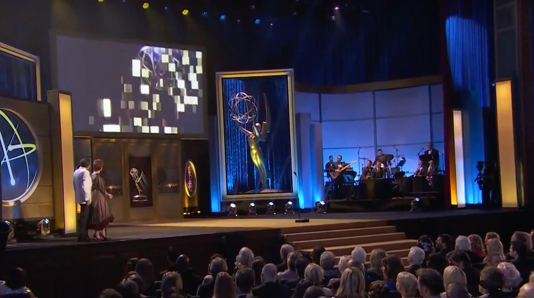 Wide shot of Carolyn on emmys stage