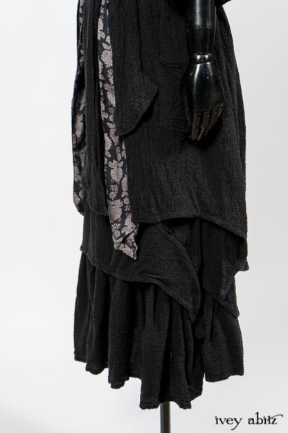 Elsie Duster Coat in Black Puckered Check Weave; Limited Edition Blanchefleur Sash in Wolfie Grey Floral Voile; Blanchefleur Frock in Black Puckered Check Weave. By Ivey Abitz