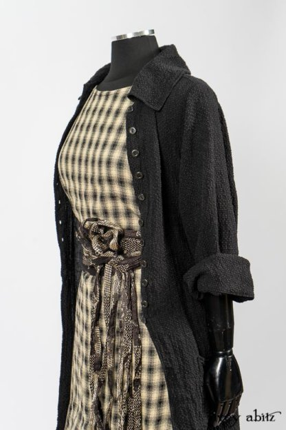 Elsie Duster Coat in Black Puckered Check Weave; Blanchefleur Frock in Black and Natural Plaid Weave; Porte Cochere Sash in Black and Natural Embroidered Floral Weave. By Ivey Abitz