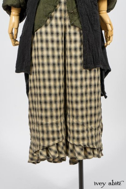 Elsie Duster Coat in Black Puckered Check Weave; Limited Edition Arthur Hill Shirt in Arthurian Green Cotton Voile; Blanchefleur Trousers in Black and Natural Plaid Weave. By Ivey Abitz