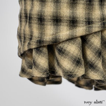 Blanchefleur Trousers in Black and Natural Plaid Weave; Limited Edition Arthur Hill Shirt in Arthurian Green Cotton Voile. By Ivey Abitz