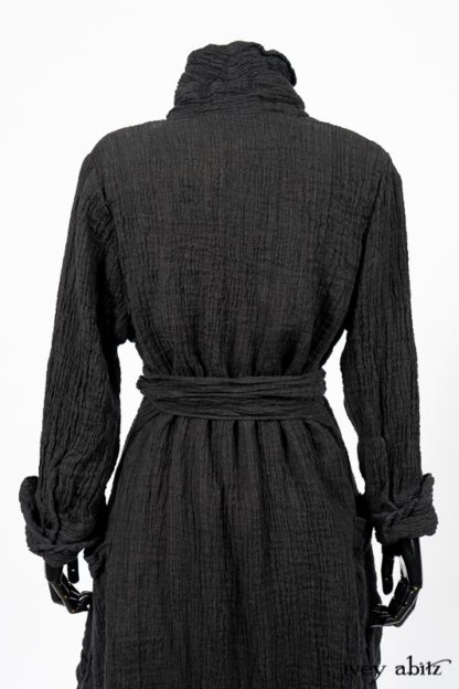 Scattergood Duster Coat in Black Crinkled Washed Linen; Scattergood Frock in Arthurian Green Floral Washed Linen. By Ivey Abitz