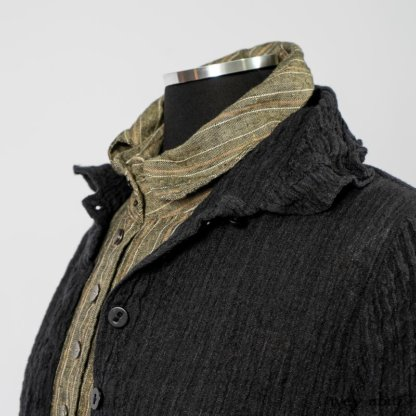 Scattergood Duster Coat in Black Crinkled Washed Linen; Scattergood Frock in Arthurian Green Floral Washed Linen; Truitt Shirt in Peace and Civility Stripe Linen. By Ivey Abitz
